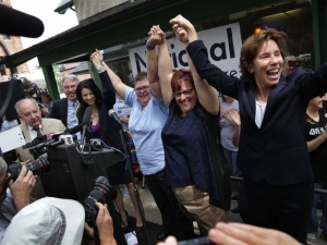 Wayne State University law professor Robert Sedler, left. attorney Kenneth Mogill, attorney Dana Nessel, April DeBoer, Jayne Rowse and attorney Carol Stanyar celebrate with the crowd after the U.S. Supreme Court found gay marriage bans unconstitutional in Ann Arbor on Friday, June 26, 2015. (Photo: Romain Blanquart, Detroit Free Press)