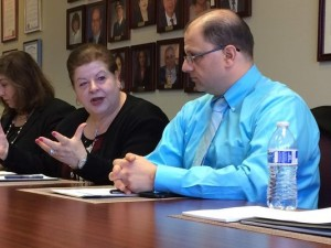 From left, Nida Samona, vice president of operations for the Arab American and Chaldean Council, and Zafer Obeid, right, a physician at the council's Community Health Center, listen as the council's president and CEO, Haifa Fakhouri discusses ways organizations that serve refugees can work together to better serve exiles. (Photo: Charles E. Ramirez / The Detroit News)