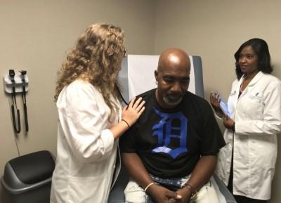 Corktown Health Center examines a patient