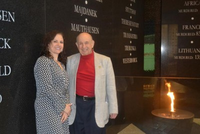 Guy Stern, a Holocaust survivor, and Ruth Bergman, director of education at the Holocaust Memorial Center, demonstrate the museum's eternal flame. The flame memorializes all those who died in the Holocaust, especially those who perished without survivors. The museum is holding a special commemoration of Yom HaShoah, or Holocaust Remembrance Day. The numbers on the wall tell how many people died in each location; Stern said research done after the wall was built indicate the deaths are much higher.